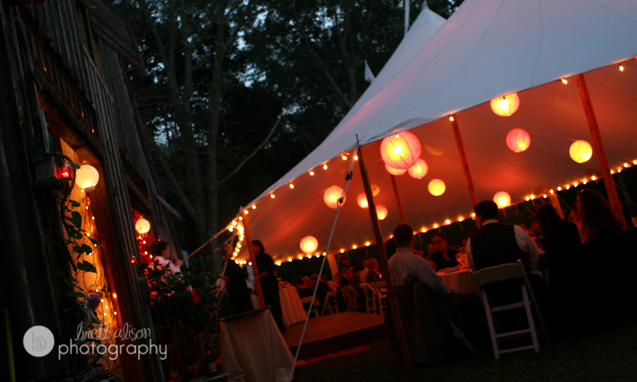 wedding tent lit up with lanterns