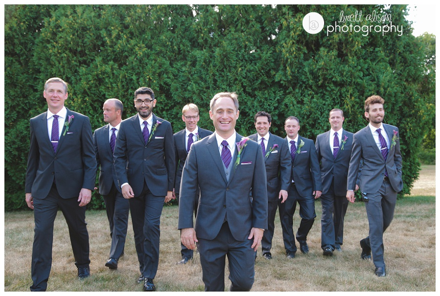 groomsmen walking wedding photos